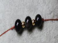 黑色尖晶石的寓意是什么?黑色尖晶石寓意着坚毅,其具有保平安的功效